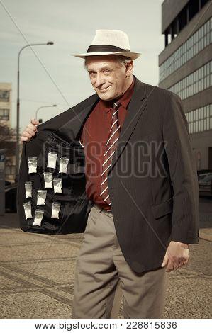 Older Dealer Of Narcotics Offering Drugs On Street