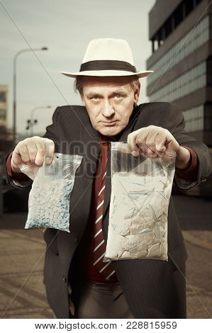 Older Dealer Of Narcotics Selling Drugs Directly On Street