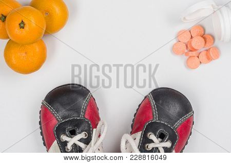 Vitamin C. Natural Citrus And Synthetic Tablets, Choice. White Background, Children's Sneakers