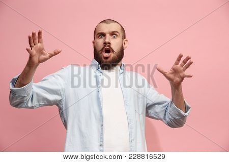 Wow. Attractive Male Half-length Front Portrait On Pink Studio Backgroud. Young Emotional Surprised