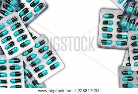 Top View Of Blue And Green Antibiotics Capsule Pills In Blister Packs Isolated On White Background W