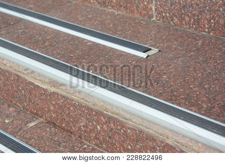 Close Up On Stair Treads And Rubber Landing Tiles Provide Slip-resistant Stair Protection And Safe F