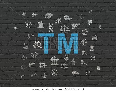 Law Concept: Painted Blue Trademark Icon On Black Brick Wall Background With  Hand Drawn Law Icons