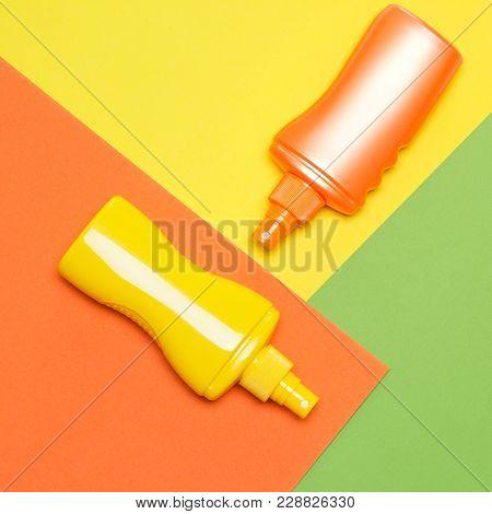Suntan Lotions On Multi-colored Blocks. Bright Summer Design
