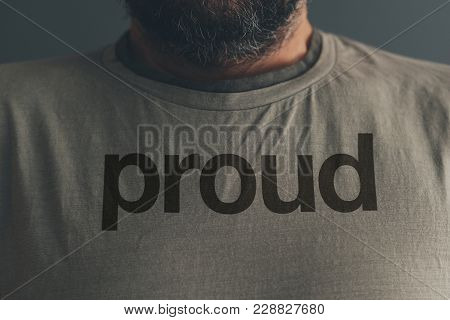 Adult Caucasian Male Wearing T-shirt With Title Proud
