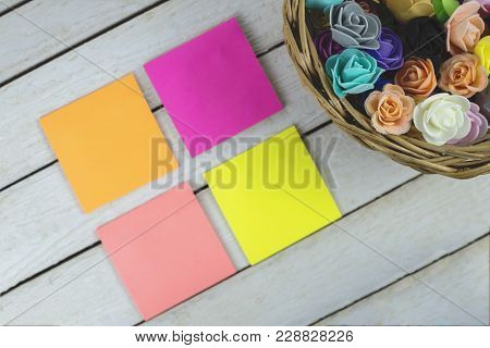 Basket Full Of Paper Flowers And Empty Paper Sticky Notes With Copy Space For Text.