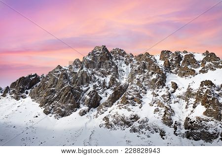 Pink Sunrise In Snowy Mountains