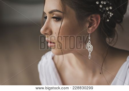 Close-up Portrait Of Girl With Beautiful Hairstyle.