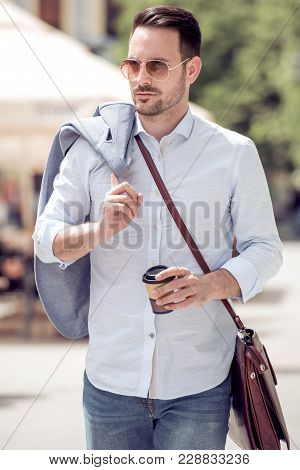 Young Man Walking The City