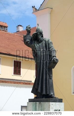 VARAZDIN, CROATIA - JULY 09: Statue of Gregory of Nin, medieval Croatian bishop of Nin in front of Saint John the Baptist church in Varazdin, Croatia on July 09, 2016.