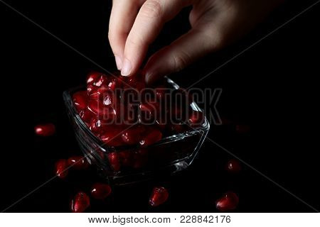 Hand Grenade Taking The Berries Out Of The Vase On The Table