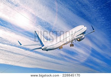 Airplane Flying In The Sky, Travel Background With Commercial Flying Airplane With Blank Livery. Air
