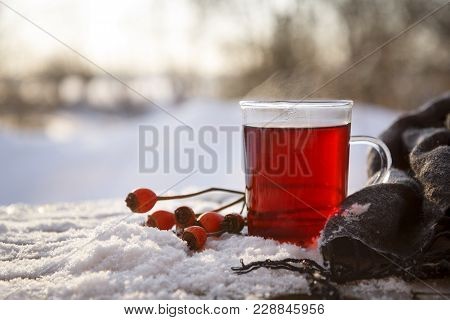 Hot Tea From Rose Hips And Hibiscus With Fruits And A Scarf Outdoors On A Cold Winter Day, The Medic