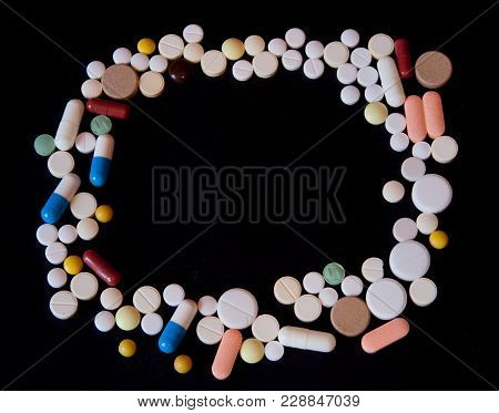 Frame Of Pills On A Dark Background With Free Space For Text, Top View.