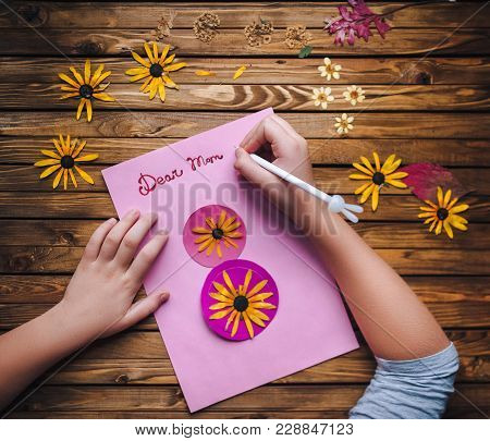 Dear Mom. Children's Hands Make A Postcard To Her Mother In Honor Of The Holiday On The 8Th Of March