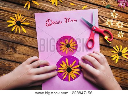 Children's Hands Make A Postcard To Her Mother In Honor Of The Holiday On The 8Th Of March. Child Cr