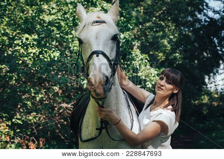 Girl And Horse In The Woods In A Summer Day