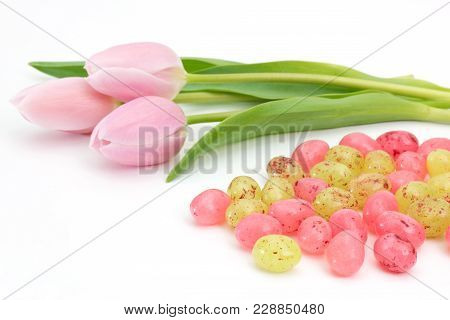 Jelly Easter Eggs Near Pink Tulips On White Background
