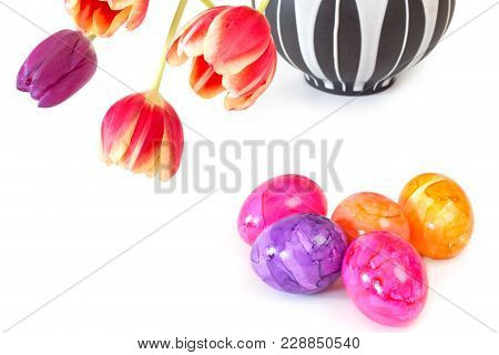 Colorful Easter Eggs With Tulips In A Vase On White Background