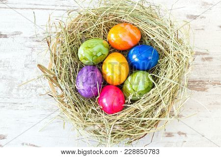 Colorful Easter Eggs In A Hay Nest