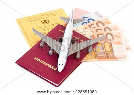 Toy Plane On Passport With Money And Vaccination Card On White Background