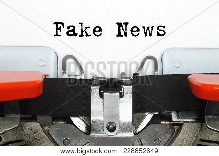 Part Of Typing Machine With Typed Fake News Words Close-up