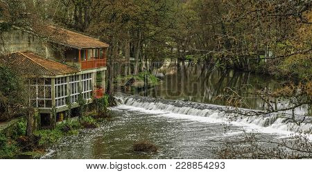 The River As It Passes Through The Medieval Village Of Allariz In Galicia, Spain