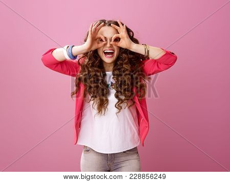 Pink Mood. Happy Trendy Woman With Long Wavy Brunette Hair Isolated On Pink Having Fun Time