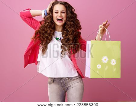 Cheerful Modern Woman Shopper Isolated On Pink Background