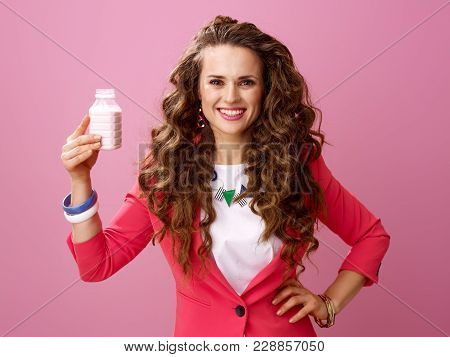 Happy Woman On Pink Background Showing Farm Organic Yogurt