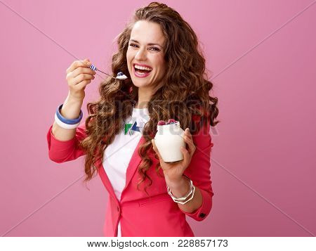 Smiling Woman On Pink Background Eating Farm Organic Yogurt