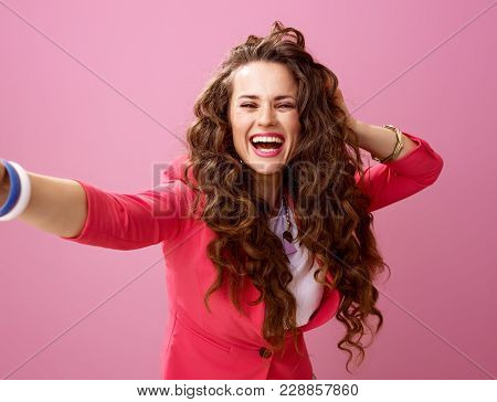 Smiling Young Woman Isolated On Pink Background Taking Selfie