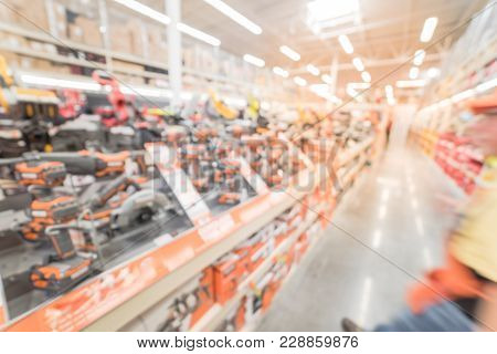 Blurred Wide Aisle Power Tool Combo Kits At Hardware Store In America