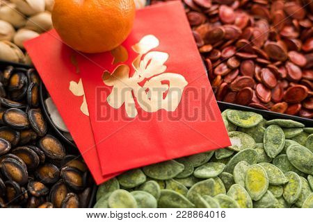 Lunar new year snack tray with red packet word mean luck