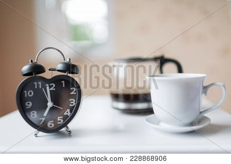 Alarm Clock Near The Bed At Home.morning Time Background Concept.