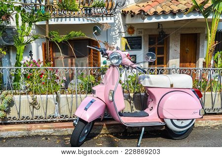 Taormina, Italy - October 1, 2017: Pink Scooter Parked In Front Of House In The Street Of Taormina I