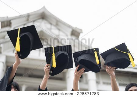 Graduation Day.many Hand Holding Row Of Graduation Hats On Sky Background. Happiness Feeling, Commen