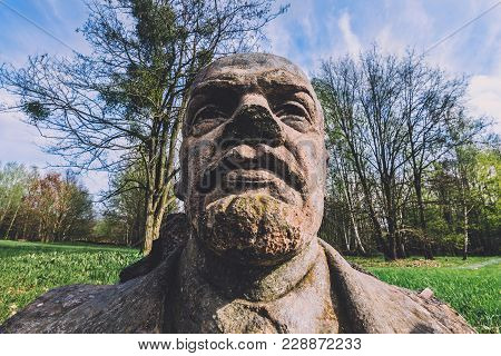 April, 10th, 2017 - Potsdam, Brandenburg, Germany. Abandoned Lenin Stone Bust In Volkspark In Potsda