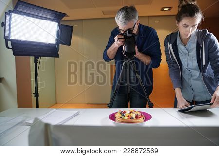 Photographer and student in photoshoot class