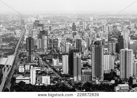 Black And White Photo. View Of The Bangkok From Above. Large Road Interchange. Skyscrapers Downstair