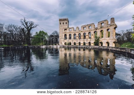 April, 10th, 2017 - Potsdam, Brandenburg, Germany. Antique Roman Theater Ruins Construction Reflecte