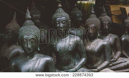 Big Buddha Statues In The Local Thai Market. Antique Buddha Statues Close-up