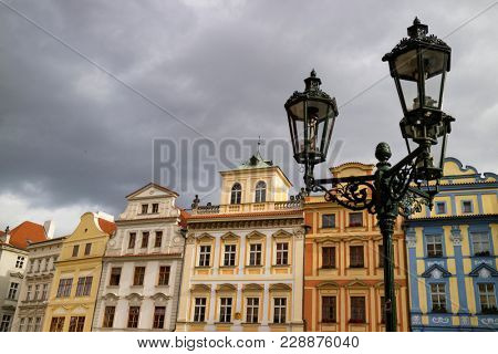Prague, Czech Republic - October 9, 2017:   Ancient colorful houses on old town square, Mala Strana, with clouded sky, Prague, Bohemia