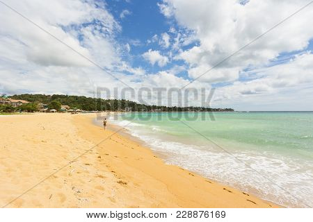 Unawatuna, Sri Lanka, Asia - A Young Woman Walking At The Beach Of Unawatuna