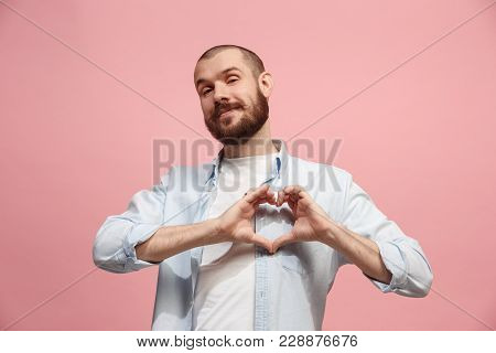 I Love You. Portrait Of Attractive Man At Pink Studio. Beautiful Male Portrait. Young Happy Emotiona