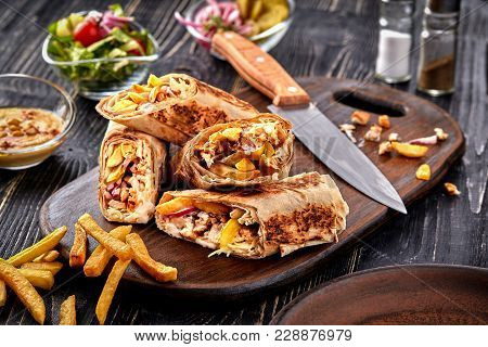 Middle Eastern Chicken Shawarma, Pita Sandwich, Roll In A Pita With Fresh Vegetables, Cream Sauce An