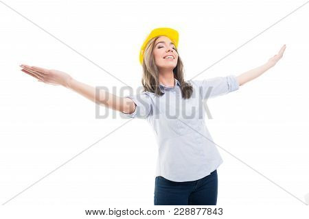 Portrait Of Female Constructor With Arms Spread Smiling.