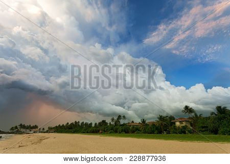 Ahungalla Beach, Sri Lanka, Asia - Huge Clouds And Various Light During Sunset At The Beach Of Ahung