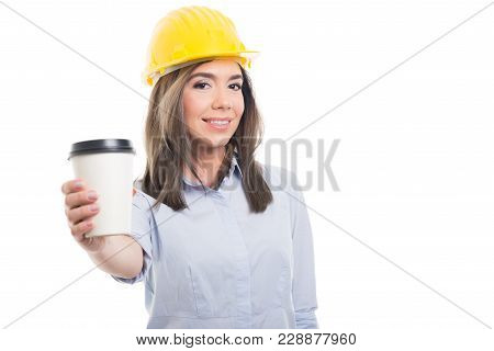 Pretty Female Constructor Offering Takeaway Coffee.