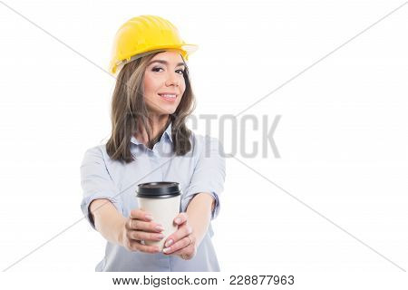 Pretty Female Constructor Holding Takeaway Coffee.